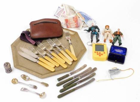 Various silver plated flatware, small quantity of action figures, low grade African silver tray, various bank notes, miniature Pacman hand held game, various other items, etc. (a quantity)