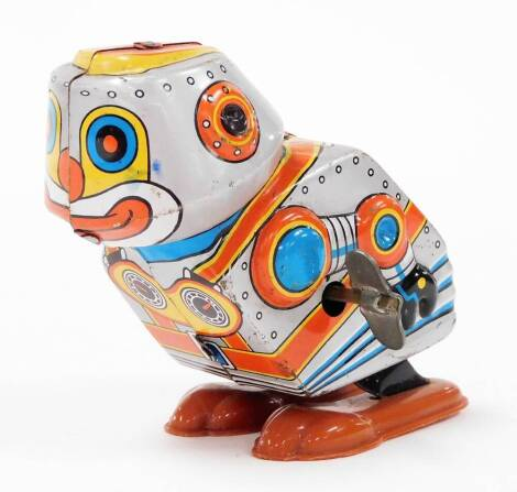 A 1970's Yone Japanese tin plate clockwork robot toy, no. 2097, with fixed key, 10cm high.