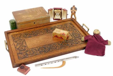Treen collectables, etc., an early 20thC heavily caved oak tray of rectangular form with metal handles, 53cm wide, carved pipe, Japanese lacquer box, glass ink bottle in green Bakelite case, travel clock, monkey hand puppet, etc. (a quantity)