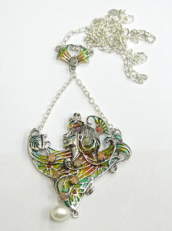 A plique-a-jour necklace, depicting a woman set with opals, rubies and marcasite, white metal, marked 925, 21.6g all in.