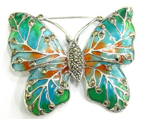 A plique-a-jour butterfly brooch/pendant, set with marcasite in orange and green, 6cm wide, 15.6g all in.