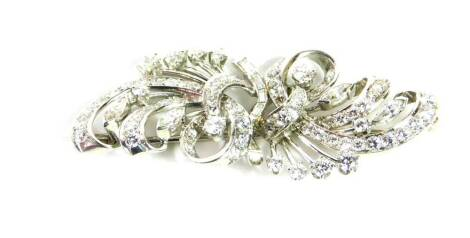 A diamond set spray brooch, of tied scrolling form, set with brilliant and baguette cut diamonds, in white metal, approx 2.6cts, 13.5g. NB. Please note we have specific instructions from the vendor to sell WITHOUT RESERVE.