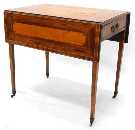 An early 19thC mahogany and satinwood and crossbanded Pembroke table, the rectangular top inlaid with a bow, quiver and a horn, within a crossbanded oval with a moulded edge above an end drawer opposing a false drawer on square tapering legs and brass cas