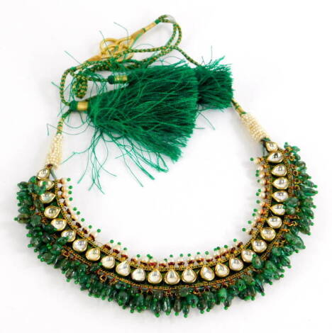 An Indian dress necklace, made up of various rectangular enamelled panels, the front set with seed pearls and clear paste stones, with jade beaded drops, with red and green enamel decoration, on a cream red and green enamel flower back, yellow metal unmar