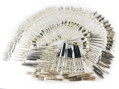 An associated canteen of 19thC and later silver Kings pattern cutlery, comprising an set of twelve dessert spoons, London 1818 by Josiah and George Piercy (22½oz), a set of twelve table forks, London 1823, possibly by William Stroud, (38oz), a set of twel