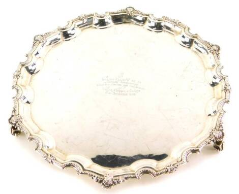 An Elizabeth II silver salver, the shaped piecrust border cast with shells, etc., engraved to the centre, William Elliott M.C, C.A in sincere appreciation from his friends and colleagues in William Murray and Co Limited, 21st December 1965, Birmingham 196