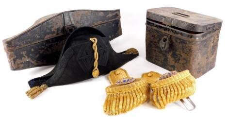 A Naval bicorn hat, with a fitted toleware case, and a pair of Epaulettes in toleware box stamped H. Walker H.I.M, stamped for Jones and Co tailor. Provenance: By family repute owned by a previous governor of the Andaman Islands.
