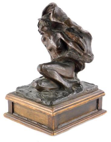 W.M.R. Nude figure of a lady, on a rectangular base, bronze on oak plinth, the figure 21.5cm high, the plinth 7cm high.