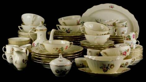 An extensive Royal Copenhagen porcelain dinner and tea service, decorated with flowers, on a beige coloured ground with scaled borders and gilt rims, to include large meat dish, various dinner plates, side plates, cups, saucers, two handled bowls, coffee
