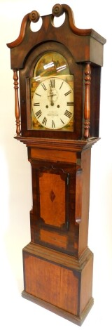James Barnes, Gainsborough. A mid 19thC longcase clock, the arched dial painted with churches and other historic buildings, etc., with eight day four pillar movement in an oak mahogany rosewood and fruitwood case, (AF), 207cm high.
