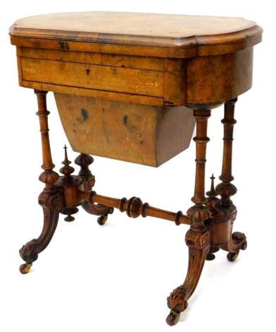 A Victorian walnut games/work table, the quarter veneered top with a burr yew crossbanded border and a moulded edge, inlaid chess, back gammon and cribbage boards in fruitwood and kingwood, above a frieze drawer fitted with compartments for cotton reels a