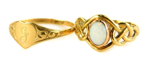 Two dress rings, to include a 9ct gold opal set dress ring, with weave design shoulders, ring size L, together with a thin 9ct gold signet ring, with heart shaped crest bearing the initial J, with scroll design shoulders, ring size Q, 3.3g all in. (2)
