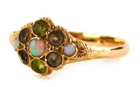 A 9ct gold Victorian style dress ring, the central floral cluster set with peridot, amethyst and opals, with fern splayed shoulders, London 1996, ring size P, 1.6g all in.