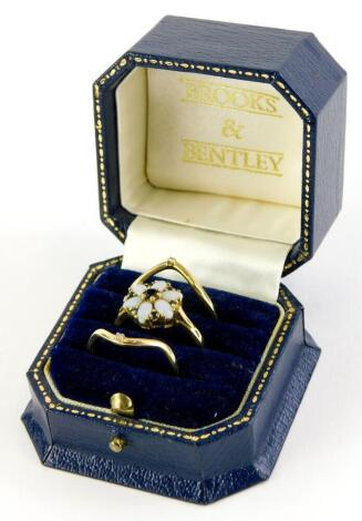 A Brooks and Bentley The Opal Dream Triple ring, with two wishbone design 9ct rings, each set with tiny diamonds, ring size T, and a central 9ct gold dress ring, set with opals and sapphires, ring size R, in presentation box, with certificate, 5g all in.