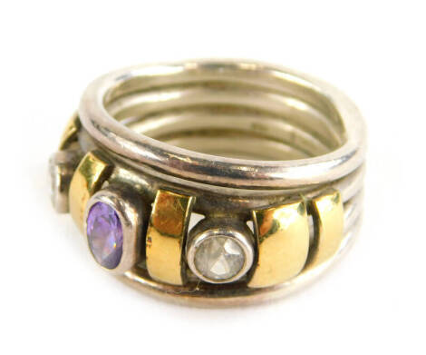 A dress ring, set with oval cut amethyst and two round brilliant cut diamonds, with yellow gold coloured breaks, on four band white metal design, marked 750 and 975, ring size P, 10.8g all in.