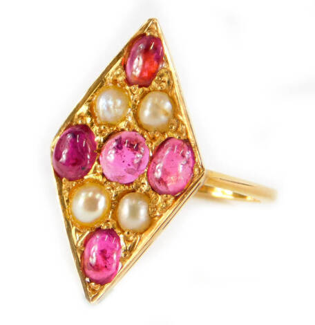 A marquise shaped ruby and pearl dress ring, the marquise design set with five rubies and four pearls, in yellow metal setting, unmarked, ring size L, 3.1g all in.