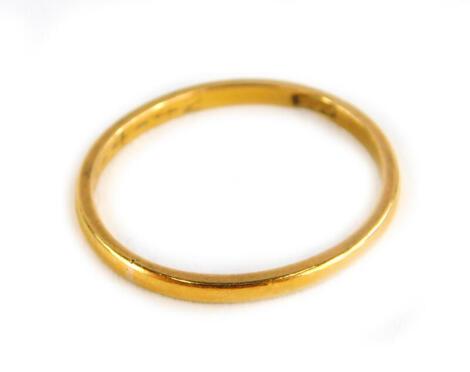 A 22ct gold thin wedding band, 1.6g.