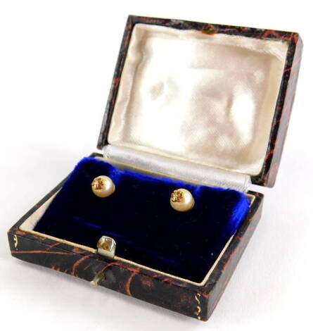 A pair of cultured pearl earrings, each with single pearl and gold six point flower end, on screw on butterfly backs, yellow metal, unmarked, 2.6g all in, boxed.