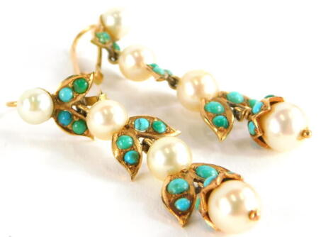 A pair of turquoise and pearl earrings, each of three tier design, with cultured pearl, in yellow metal frame, unmarked, 4cm high, 7.7g all in.