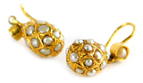 A pair of seed pearl bead earrings, each with drop bead Eastern design, in yellow metal frame, unmarked, 3.4g all in.