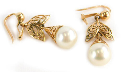 A pair of drop earrings, each with natural pearl drop, in a pierced wirework framing, yellow metal, unmarked, 6.1g all in.
