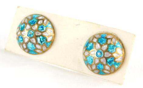 A pair of silver gilt and enamel earrings, each with blue and white enamel, with screw on backs.