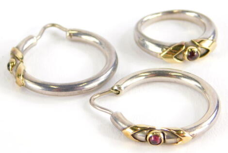 A ring and earring set, the ring on white metal band with yellow metal V shoulders and a central garnet in rub over setting, unmarked, possibly white and yellow gold, ring size I½, 14.3g all in.