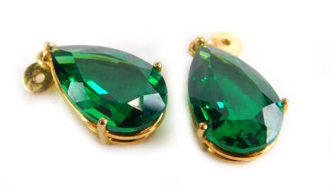 A pair of green paste stone earring drops, in gold plated frame with single loop to top.