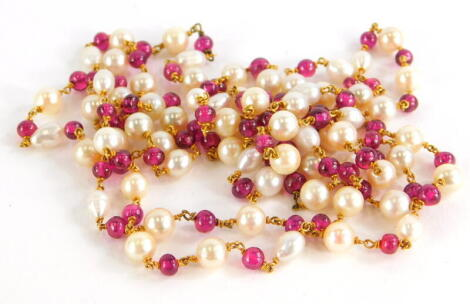 A pearl and garnet longuard necklace, with various blister and cultured pearls, with round beaded garnets, with yellow metal links, unmarked, 62cm long overall, 44.4g all in.