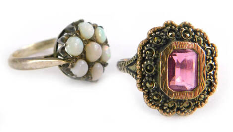 Two silver dress rings, to include an opal floral cluster ring, ring size L, and a 9ct gold and silver garnet and marcasite dress ring, with V splayed shoulders, ring size O½. (2)