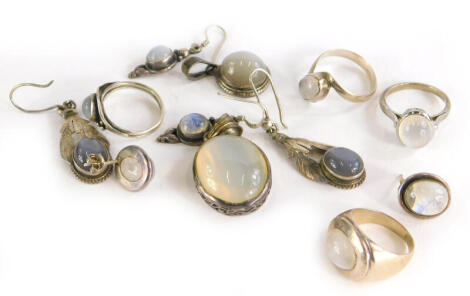 A group of moonstone jewellery, to include a pendant in silver frame, four silver dress rings, two pairs of silver drop earrings, a pair of silver studs and a silver pendant. (9)
