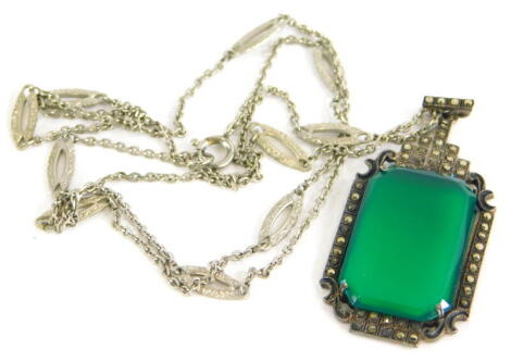 A silver and marcasite pendant, with rectangular cut green jade, with marcasite Art Deco style border, white metal, marked 935, on a silver plated chain.