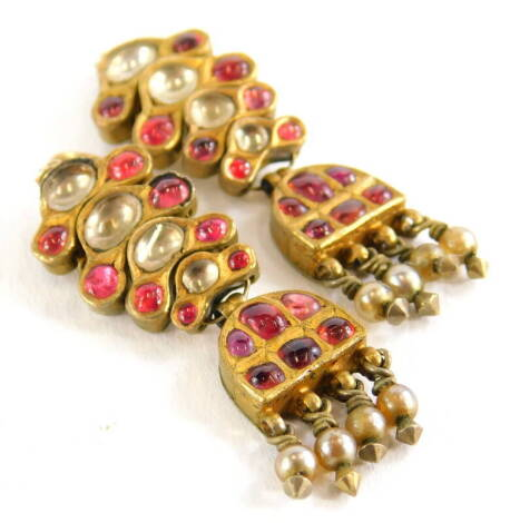 A pair of rolled gold and paste stone set drop earrings, each with red and white stone design, with pearl tassel drops, rolled gold.