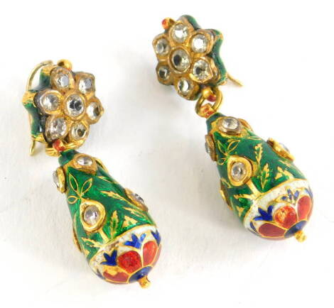 A pair of diamond and enamel drop earrings, the top in the form of a floral cluster set with seven old cut diamonds, on a pendant drop, set with various tiny diamonds, on a green enamel background, with a red, cream and blue flower to base, yellow metal,