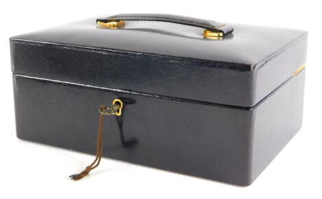 A brown leather Asprey London jewellery box, the box with key lock, metal hinges, single shelf with two lift up compartments, with brown velvet interior, 9cm high, 22cm wide, 15.5cm deep.