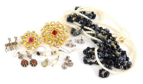 A group of costume jewellery, to include faux pearl necklace, two gold plated and paste stone set brooches, silver and other earrings and dress rings, paste stone set floral earrings, marcasite two deer brooch, etc. (a quantity)
