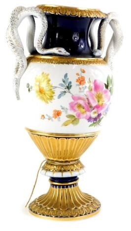 A late 19th/early 20thC German porcelain vase, pained with flowers within gilt and cobalt blue borders, mounted with two serpent shaped handles, blue Meissen type cross swords marked to underside, 28cm high.