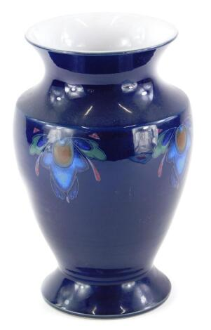 A Denby vase, decorated with Art Nouveau motifs on a cobalt blue ground, printed marks to underside, 26cm high.