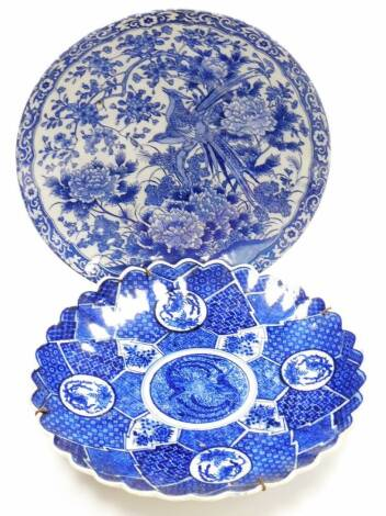 A Japanese Meiji style pottery plate, transfer printed with exotic birds and flowers, 31cm diameter, further 19thC blue and white plate, decorated with panels of birds and flowers. (2)