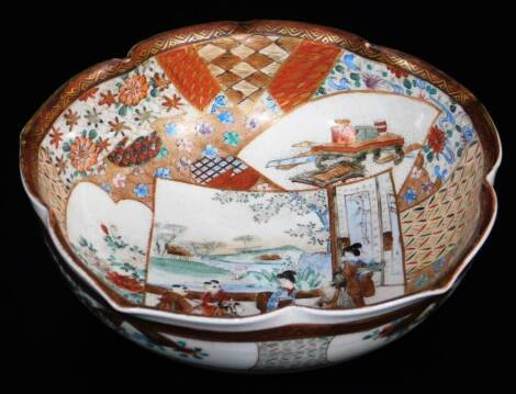 A Japanese lobed Satsuma bowl, decorated with overlapping shaped panels depicting women and children in a garden, books and gifts on a table, chrysanthemums, diaper designs, floral patterns, etc., the exterior with bands of fans, flowers, etc., illegible