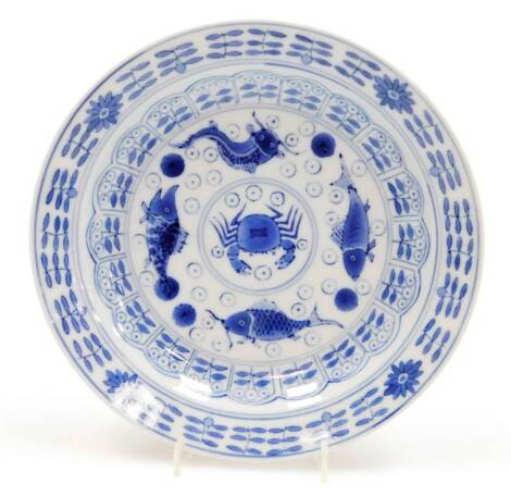 A late 19th/early 20thC Chinese blue and white saucer dish, decorated with fish, crabs, etc., in blue, four character mark to reverse, 20cm diameter.