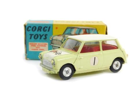 A Corgi die cast model of a Morris Mini Cooper, Competition Model, in white and pale green, with Glidamatic spring suspension, No 227, boxed.