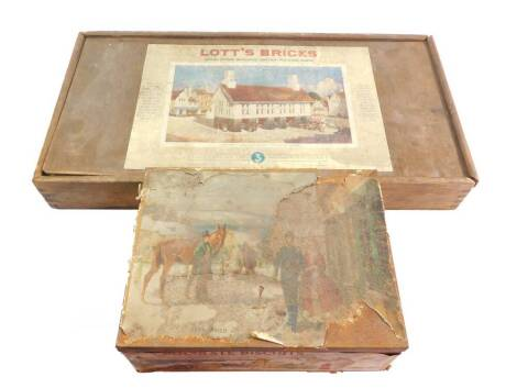 A Lott's Bricks Set No 3, plans lacking, boxed, together with a tin containing further building blocks, roofs, windows, etc. (2)