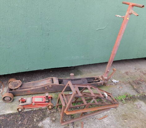 A mechanic's trolley jack, a pair of car ramps, and a Sprint hydraulic trolley jack. (4)