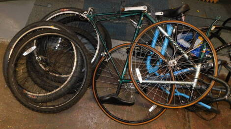 Three bicycle frames, comprising a Raleigh Pro-Race gentleman's racing bike., a Grolsch bike frame, and a DMR Bikes frame, together with assorted tyres. (a quantity)