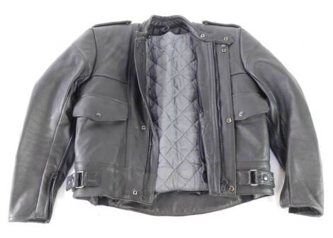 A heavy black leather motorcycle jacket, with fleece liner.