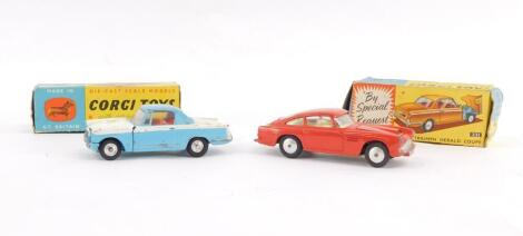 A Corgi die cast Aston Martin DB4, No 218, together with a Triumph Herald Coupe, No 231, both boxed. (2)