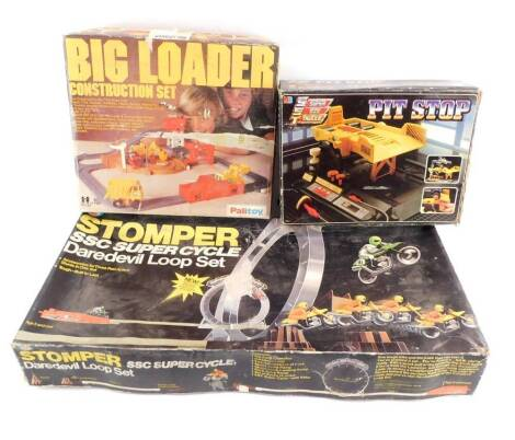 An Ideal Stomper SSC Super Cycle Dare Devil Loop Set, together with Palitoy Construction Set, and a Milton Bradley Pit Stop, all boxed. (3)