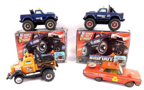 A Milton Bradley Big Foot four wheel drive truck, and another, both boxed, together with a Playskool Giant Puller Tow Vehicle, and a Daiya Japanese tin plate FD Fire Chief car, with siren. (4)