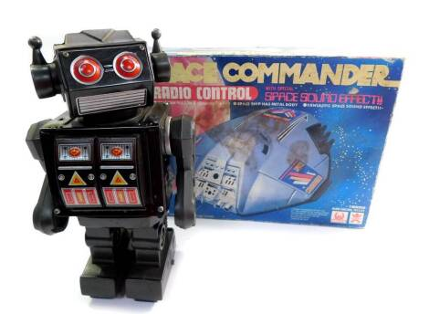 A Hales Radio Controlled Space Commander, with Special Space sound effect, 16552, boxed, together with a Japanese tin plate battery operated walking robot, with light effect attack guns. (2)